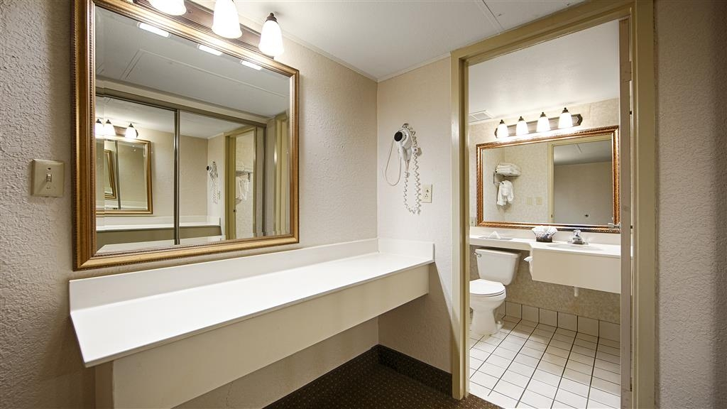Best Western Plus Ramkota Hotel - Bathrooms have a large vanity with plenty of room to unpack the necessities.