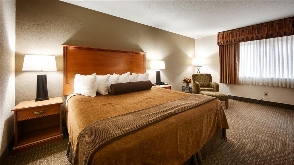 Best Western Plus Ramkota Hotel - Sink into our comfortable beds each night and wake up feeling completely refreshed.