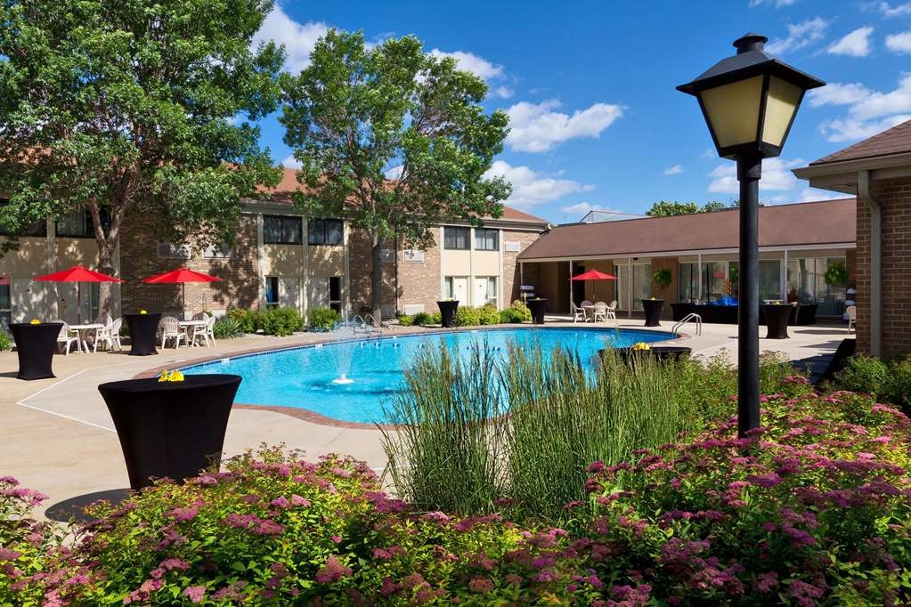 Best Western Plus Ramkota Hotel - Our heated outdoor seasonal pool and courtyard is the perfect place for a swim or relax with your favorite book.