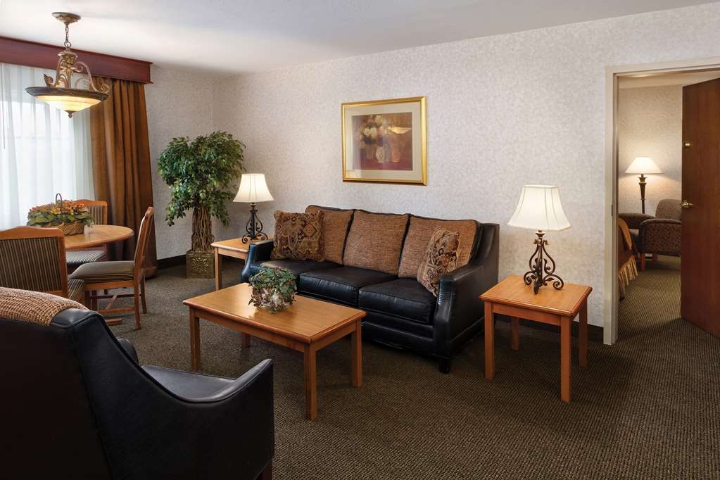 Best Western Plus Ramkota Hotel - We have additional space in this double queen family suite for visitors or your family.