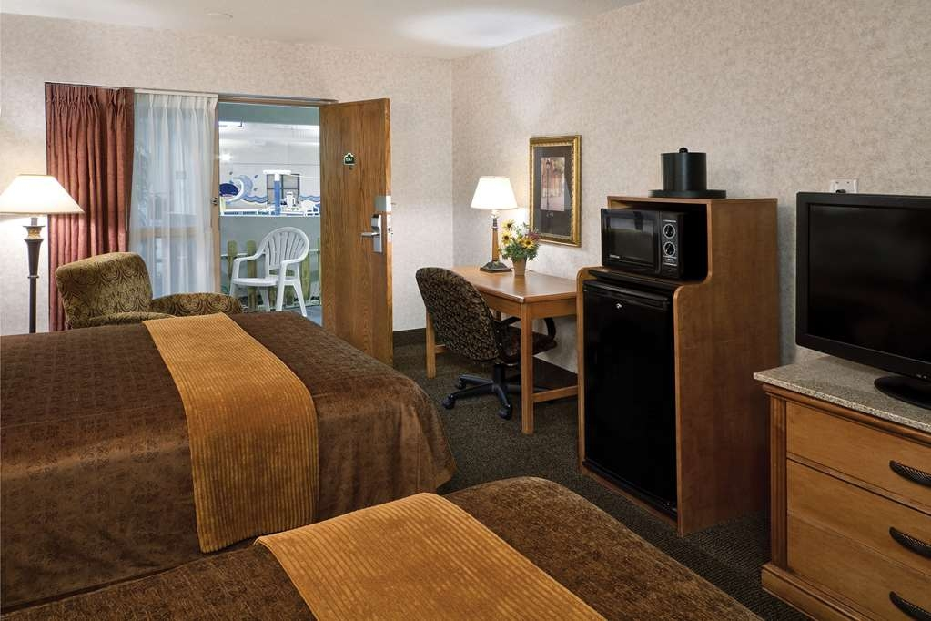 Best Western Plus Ramkota Hotel - Make yourself at home in our poolside room.