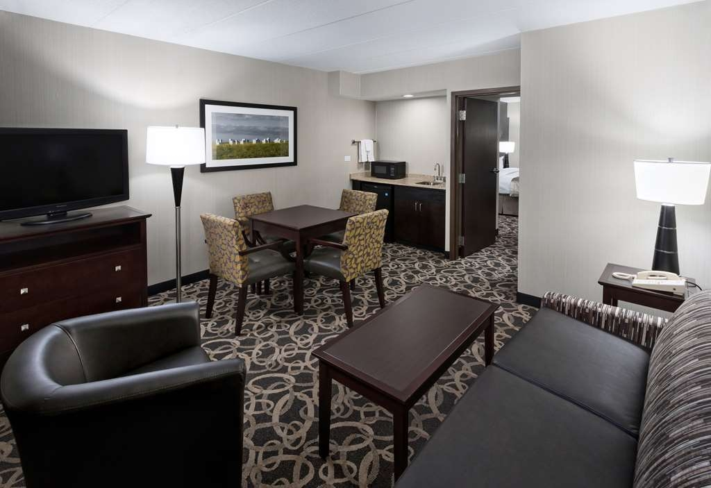 Best Western Ramkota Hotel - Come and stay in our suite king bedroom equipped with a seperate living room.