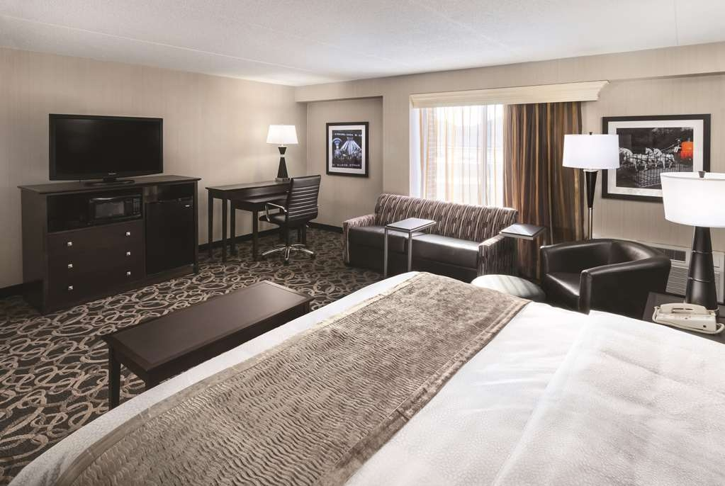 Best Western Ramkota Hotel - We offer king business plus rooms and oversized king bedrooms to meet your every need.