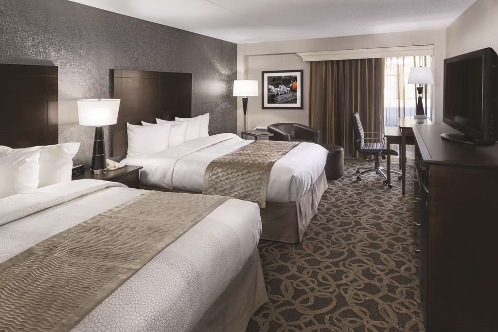 Best Western Ramkota Hotel - Our spacious double queen standard and mobility accessible rooms have all the comforts of home at your fingertips.