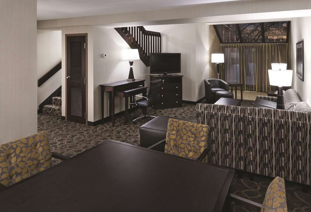 Best Western Ramkota Hotel - Staying awhile! Try our bi-level suite king bedroom featuring a sofa bed and whirlpool.