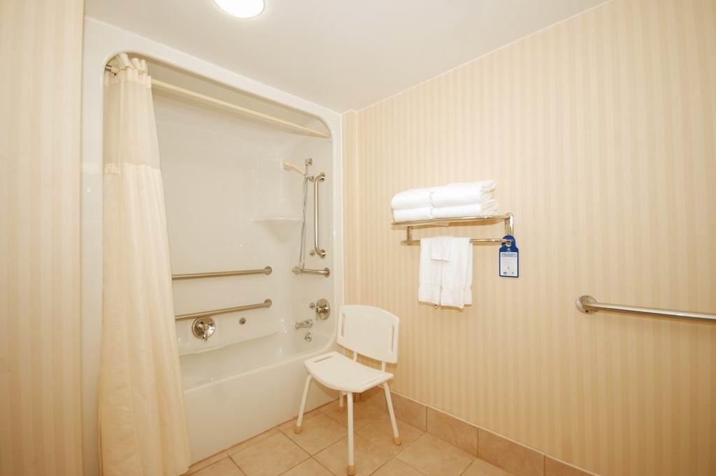 Best Western Celebration Inn & Suites - Our spacious mobility accessible guest bathroom offers easy access to the tub/shower area.