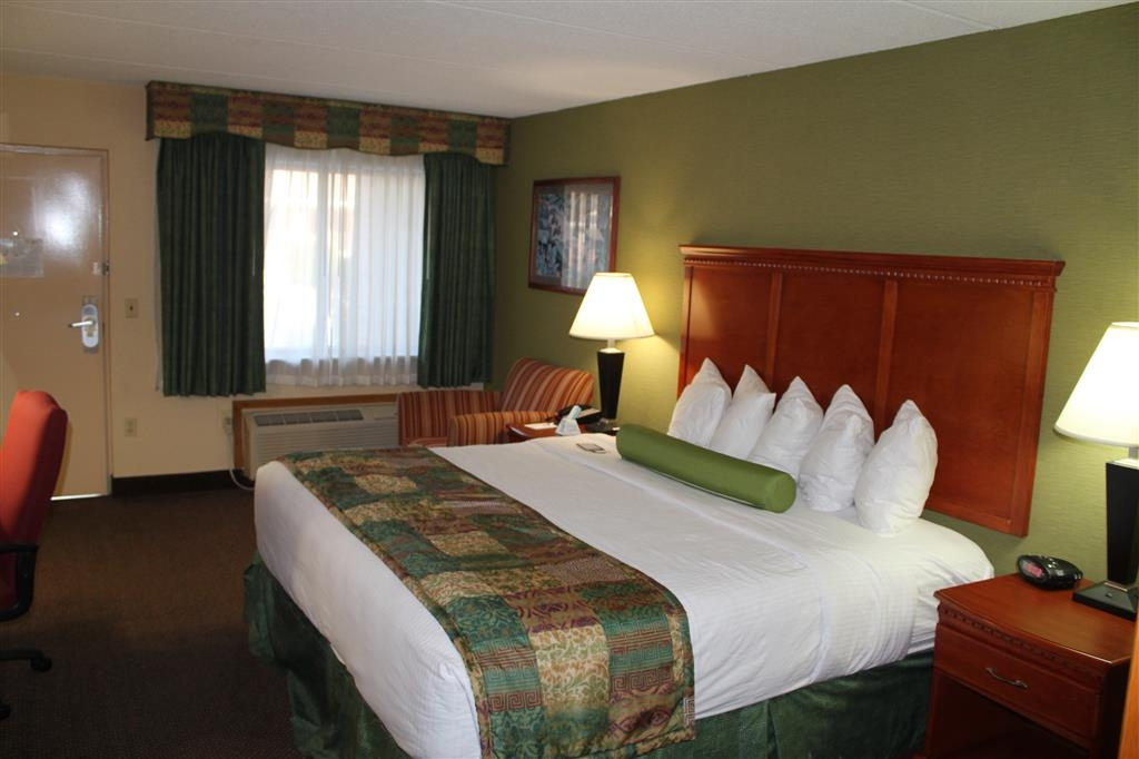 Best Western Celebration Inn & Suites - Amenities for this mobility accessible king guest room include a microwave, refrigerator and a desk with chair.