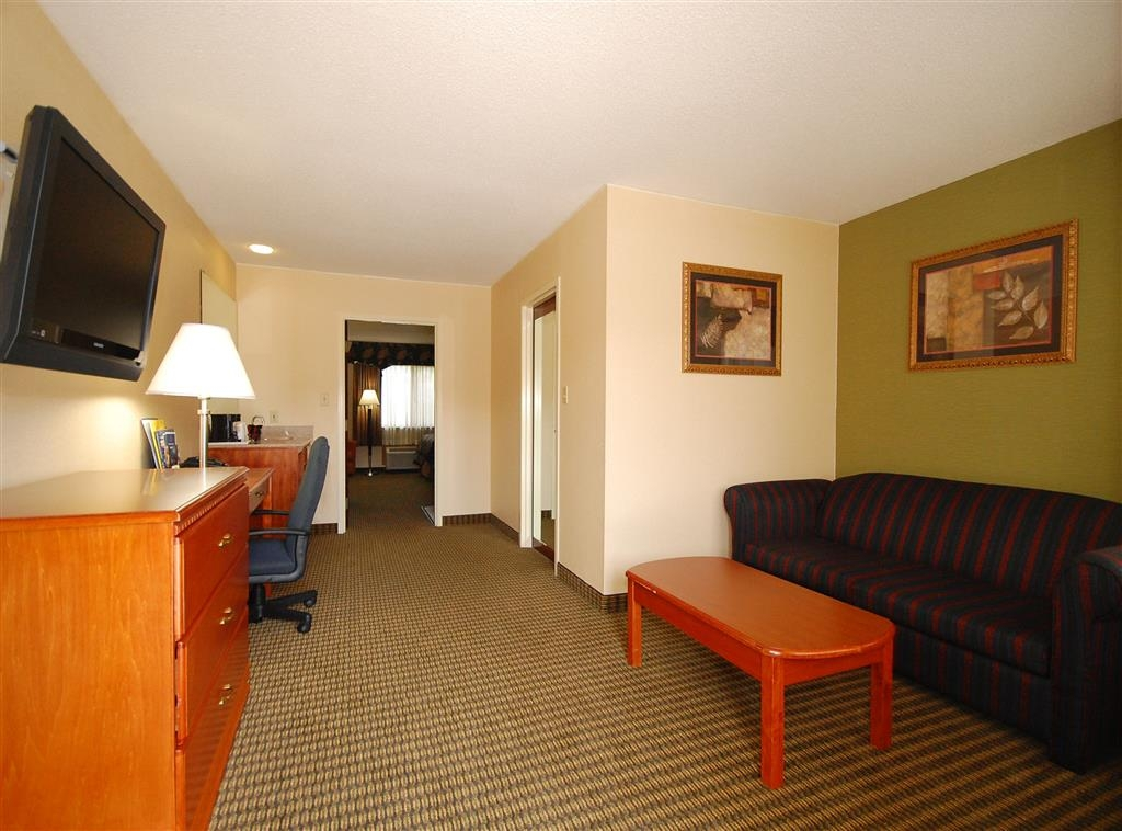 Best Western Celebration Inn & Suites - All of our suites feature a separate living room with a full-size sofabed, desk, television and much more.
