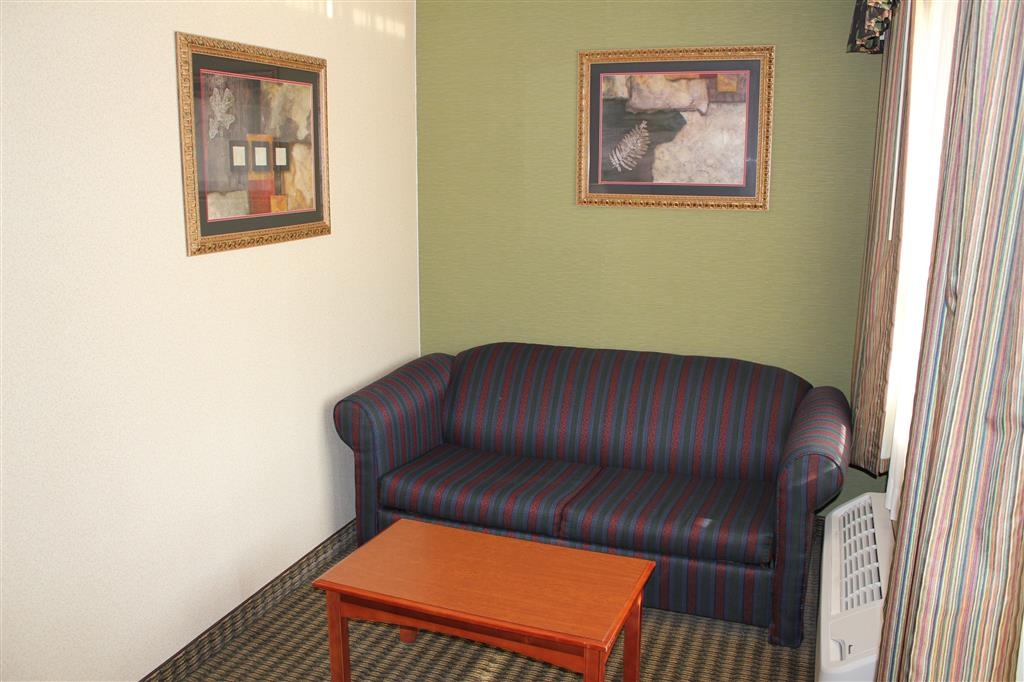 Best Western Celebration Inn & Suites - Our mobility accessible suite features a full living room with a full-size sofabed.