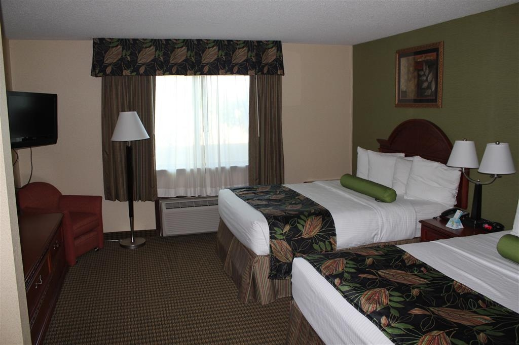Best Western Celebration Inn & Suites - The separate bedroom has two queen pillowtop beds and a 32-inch LCD TV.