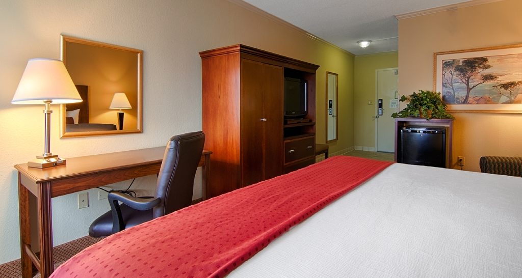 Best Western Plus Morristown Conference Center Hotel - This mobility accessible king room features a clothes wardrobe, a work desk and chair, easy chair with ottoman, and a mini refrigerator.