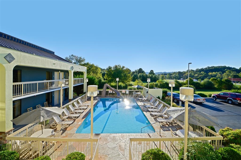Best Western Cades Cove Inn - We have plenty of chairs to relax on around our outdoor pool.