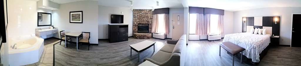 Best Western Cades Cove Inn - Sit by the fireplace in your own King Suite.