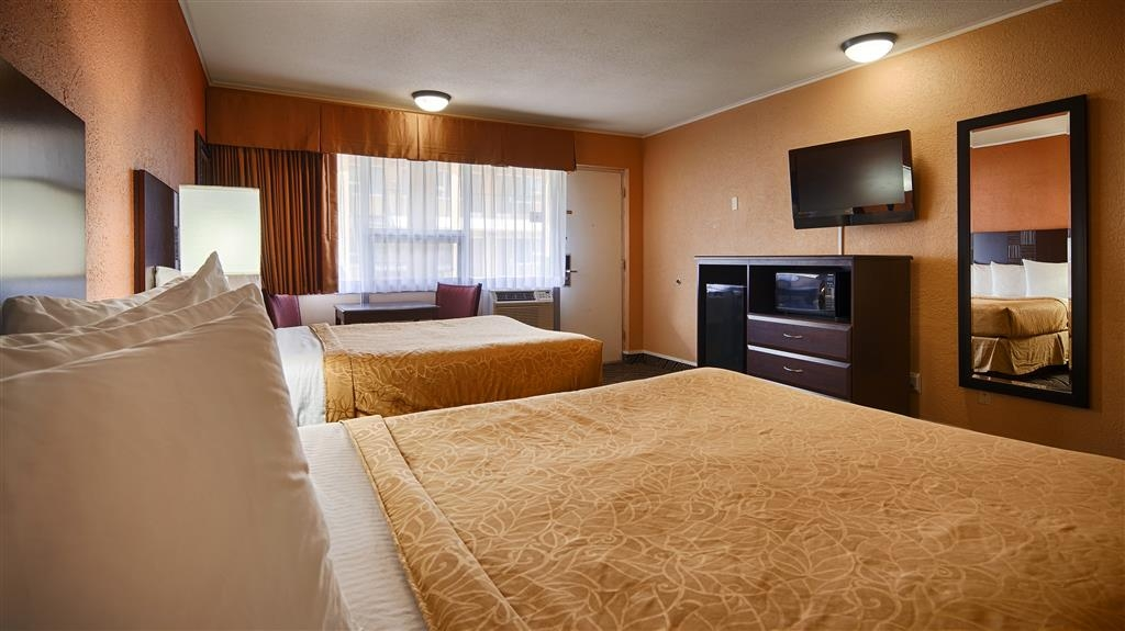 Best Western Red Carpet Inn - Our spacious two queen guest room includes all the amenities of home with triple sheeting, microwave and refrigerator.