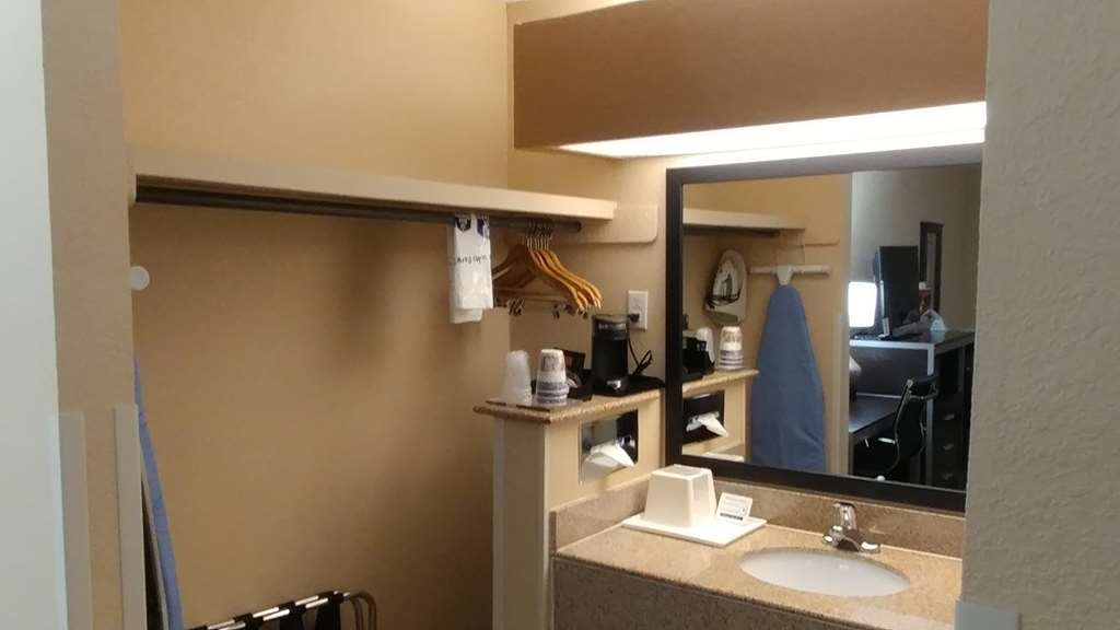 Best Western Nursanickel Hotel - Guest Room Sink With Closet attach to it.