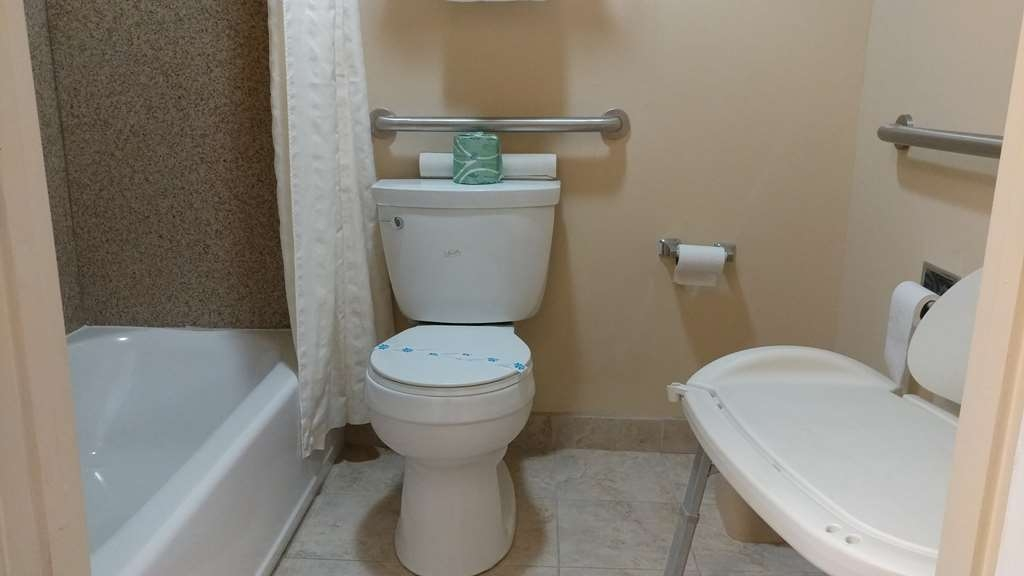 Best Western Nursanickel Hotel - There is plenty of room in this ADA mobility accessible guest bathroom with bathtub With Shower Chair.