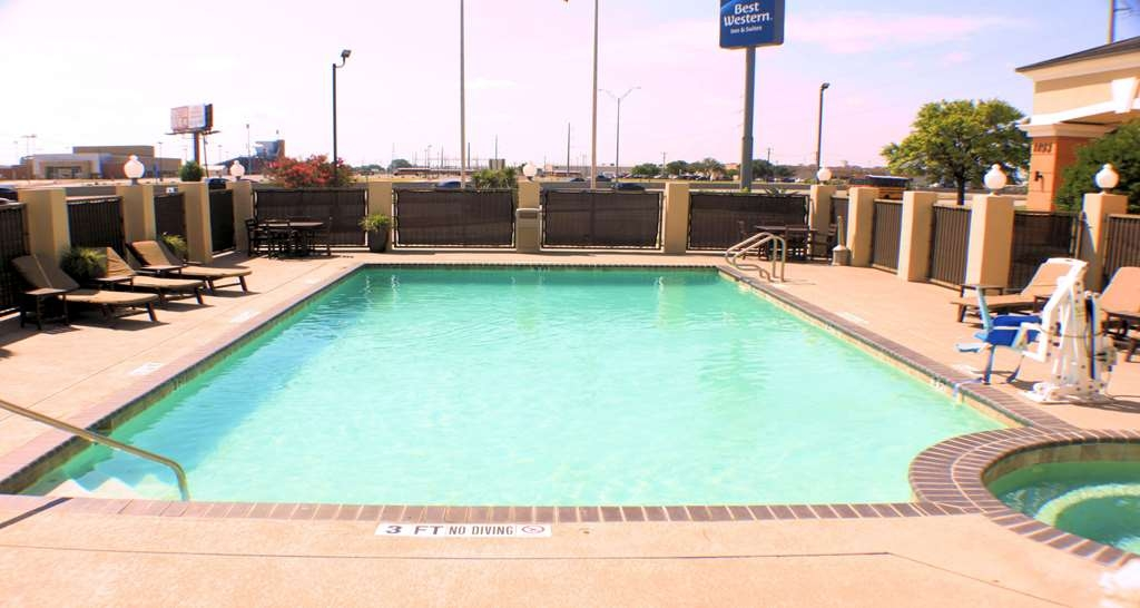 Best Western Inn & Suites - Whether you want to relax poolside or take a dip, our outdoor pool and spa area is the perfect place to unwind.