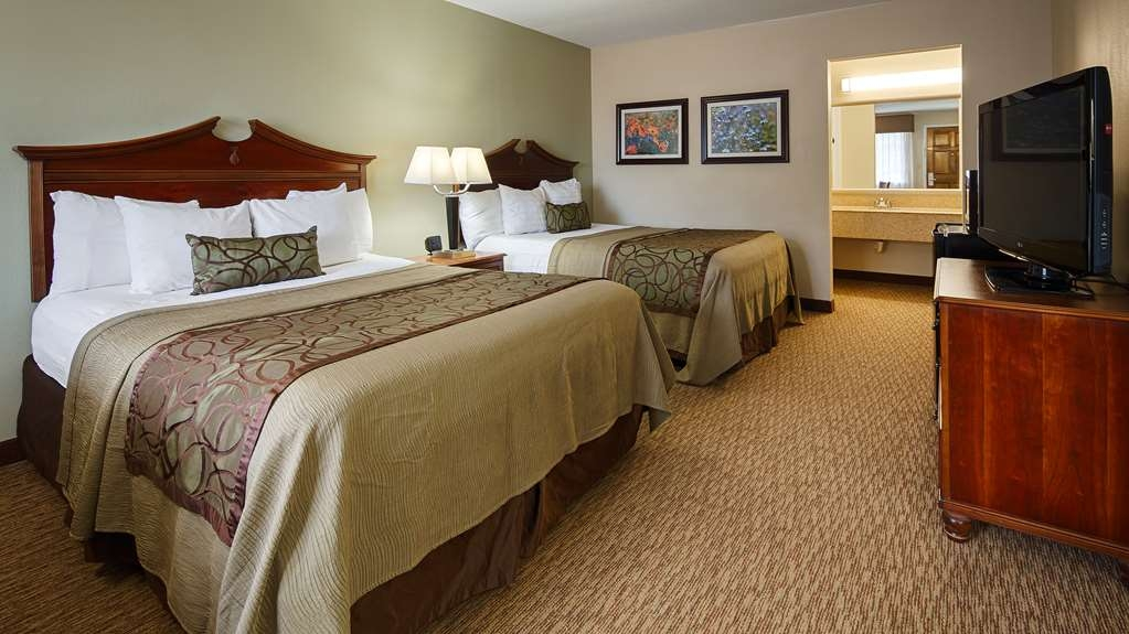 Best Western Inn of Brenham - Immediately feel at home when you walk into this two queen guest room with flat screen TV, microwave and refrigerator.