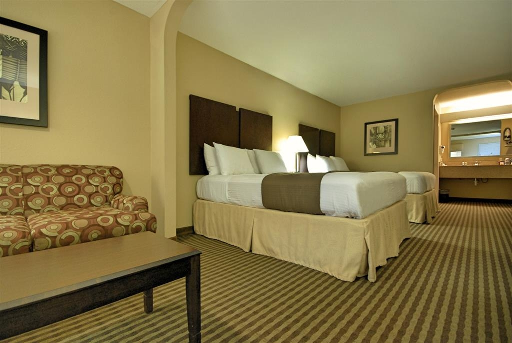 Best Western Cedar Inn - There is plenty of room for up to four guests in our spacious two queen guest room with love seat.