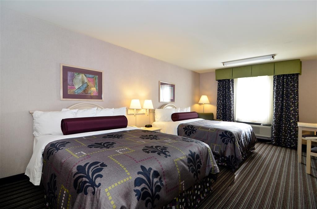 Best Western Borger Inn - Our two queen guest room is spacious and offers you a comfortable place to unwind.