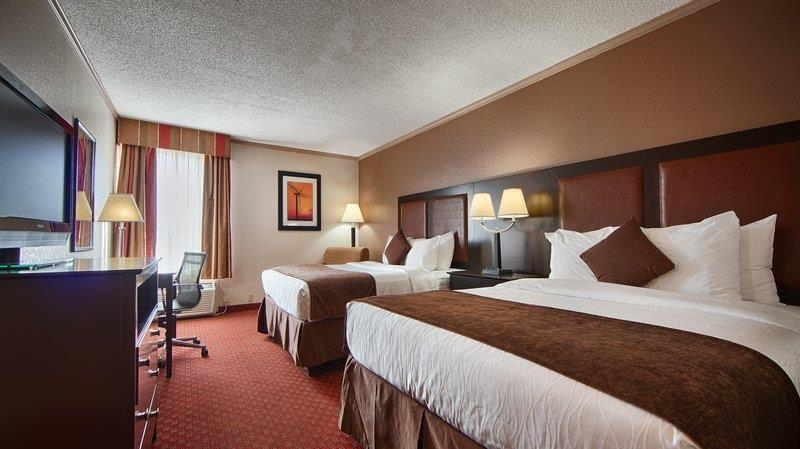 Best Western Plus Lubbock Windsor Inn - Standard Guest Room featuring Two Queen Beds, 32-inch Flat Screen TV, Refrigerator and Microwave.