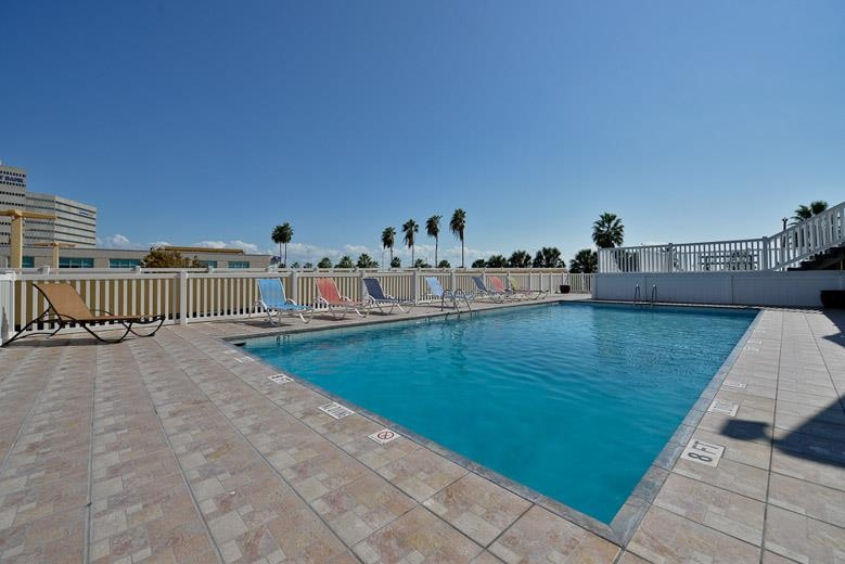 Best Western Corpus Christi - Soak up the sun in one of our comfortable lounge chairs by our outdoor swimming pool.