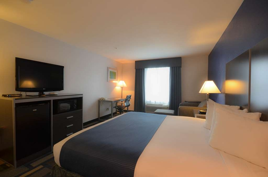 Best Western Galleria Inn & Suites - King size bed with all the amenities necessary to make you feel welcome at the Best Western® Galleria Inn & Suites.