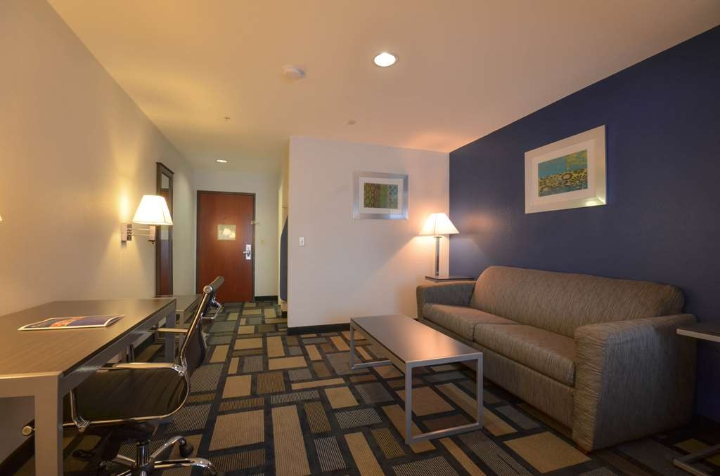Best Western Galleria Inn & Suites - Enjoy the living area inside your already spacious King and Queen Bed Suites!