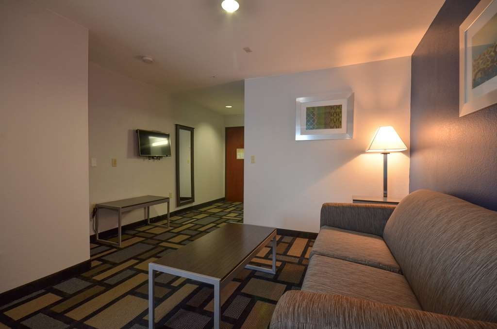 Best Western Galleria Inn & Suites - Enjoy bonus space with our living area inside your already spacious suite!
