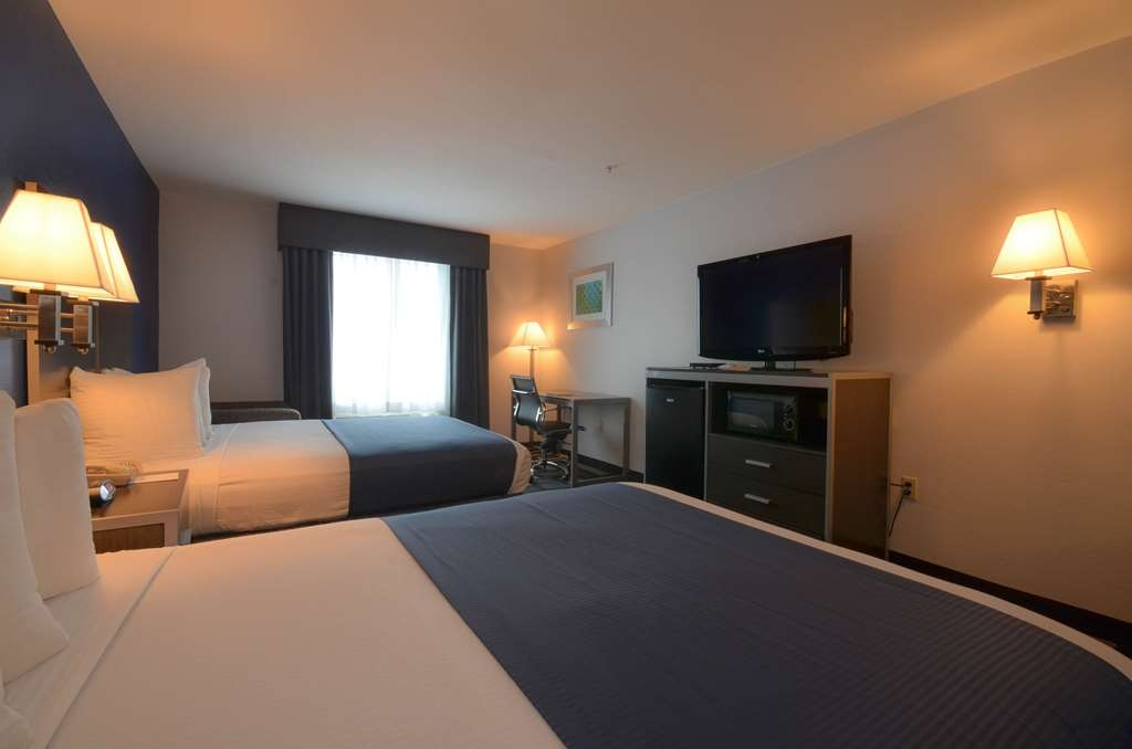 Best Western Galleria Inn & Suites - Our standard two queen bed room offers the comforts of home with a few added amenities that will make your stay special.