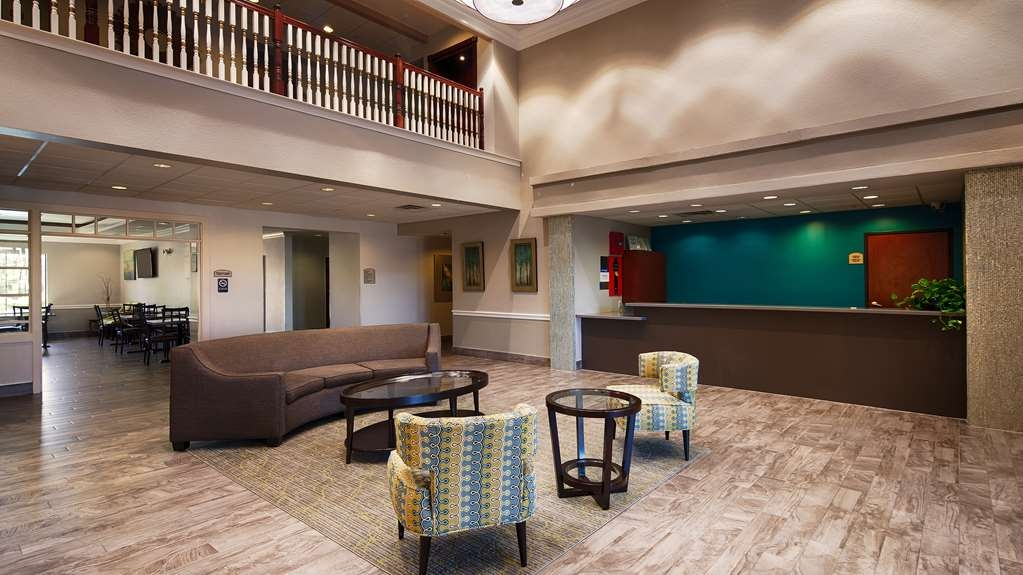 Best Western Galleria Inn & Suites - Our comfortable lobby chairs are the perfect spot to relax after a long day of work and travel.