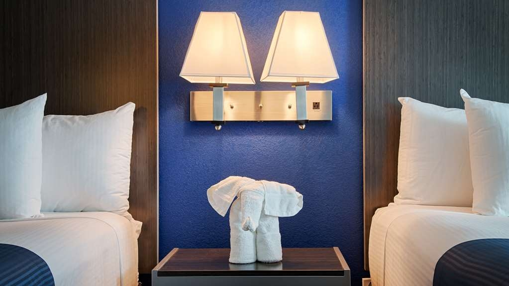 "Best Western Galleria Inn & Suites - Our official greeter ""Lucky"" the elephant hanging out in our two queen guest room."