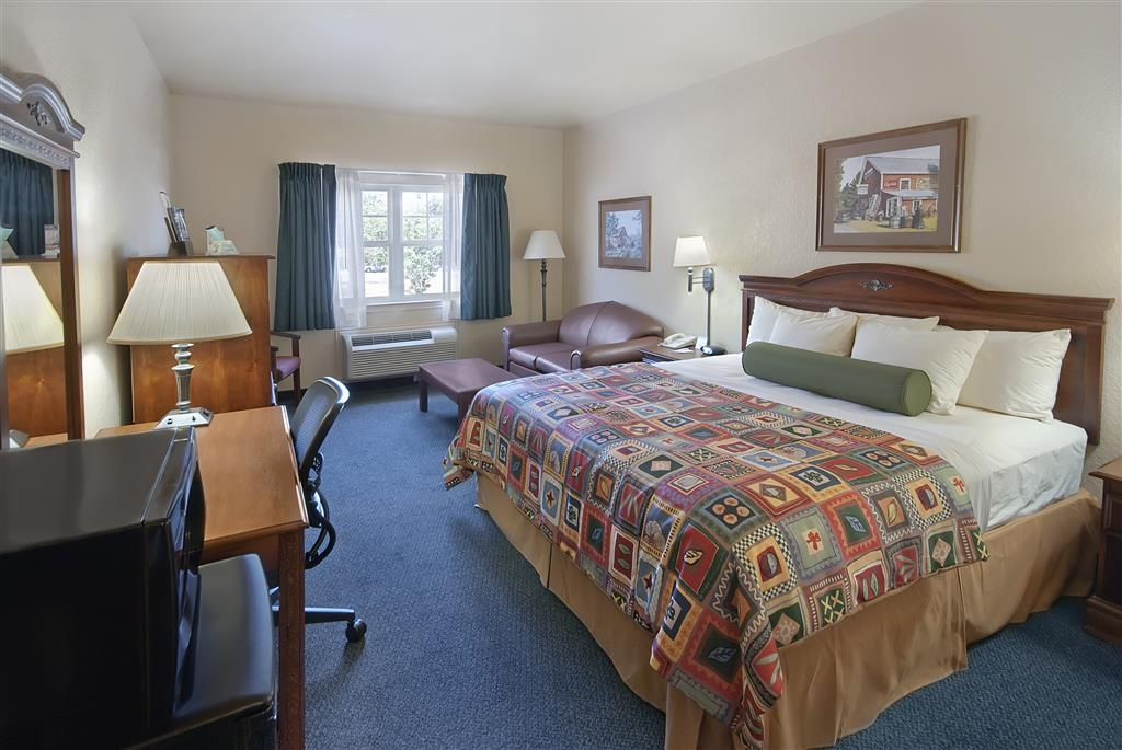 Best Western Plus Fredericksburg - Enjoy a restful night in our spacious king guest room with 32-inch HD TV, microwave and refrigerator.