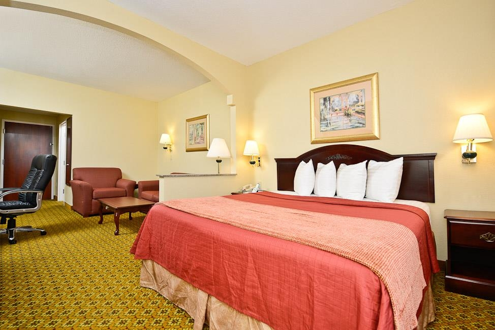 Best Western Dayton Inn & Suites - This spacious king suite offers distinct areas for sleeping, eating and working.