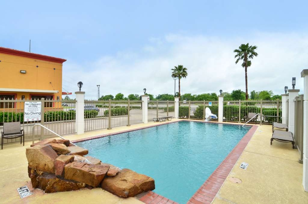 Best Western Dayton Inn & Suites - Soak up the sun in one of our comfortable lounge chairs by our outdoor swimming pool.