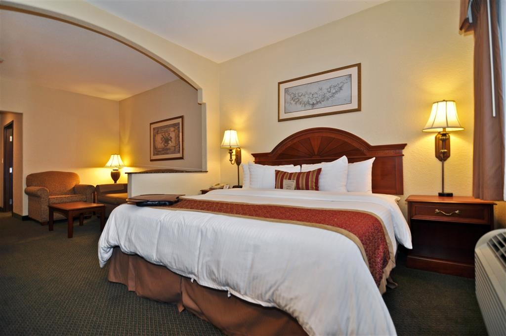 Best Western Plus Victoria Inn & Suites - King suites are furnished with a king size bed and a living room area with a pull-out sofa bed.