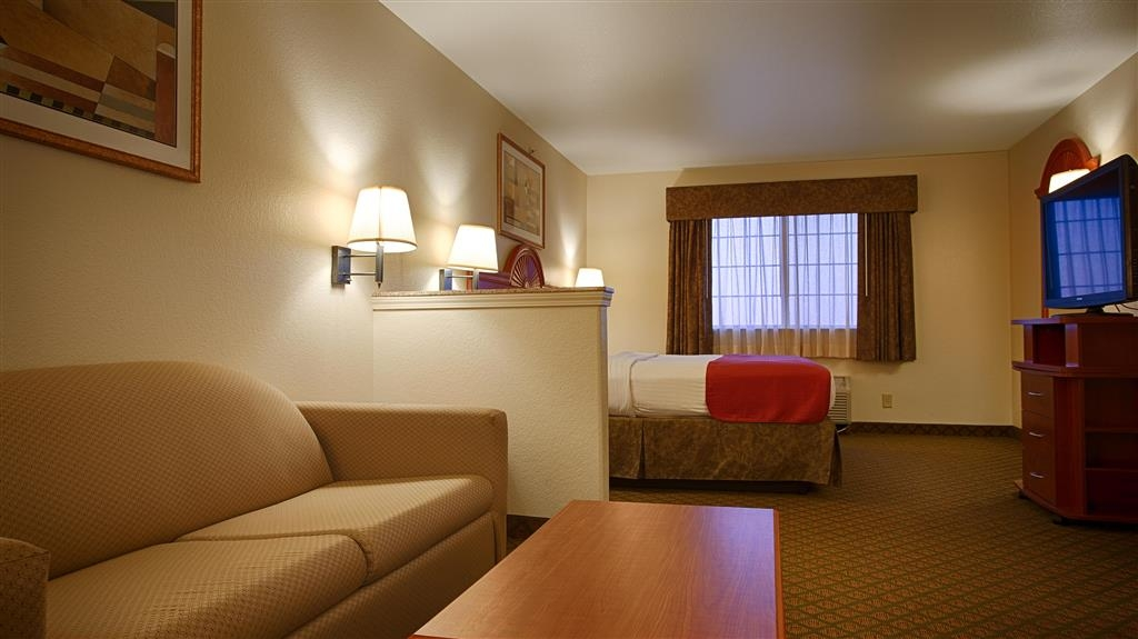 Best Western Henrietta Inn & Suites - All the comforts of home at your fingertips in this king suite bedroom.