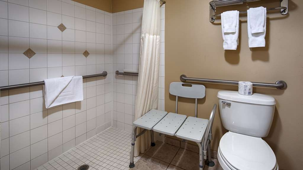 Best Western Dos Rios - Accessible Bathroom King Suite is a huge suite with a roll in shower and shower chair. This room has plenty of space for a wonderful relaxing stay.