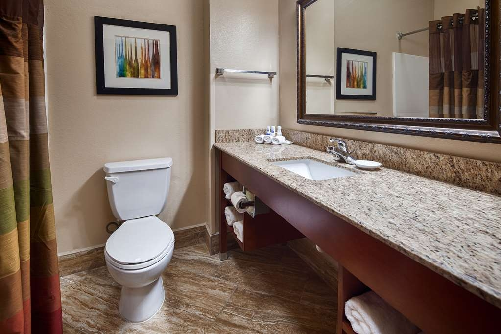 Best Western Plus Monahans Inn & Suites - All guest bathrooms have a large vanity and includes a magnifying make-up mirror, telephone and hair dryer.
