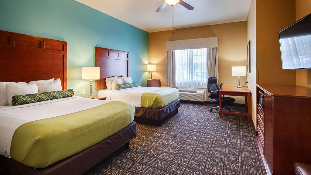 Best Western Plus Monahans Inn & Suites - Our spacious two queen guest rooms are available on all floors and feature 46-inch LED flat screen TV's with HD channels.