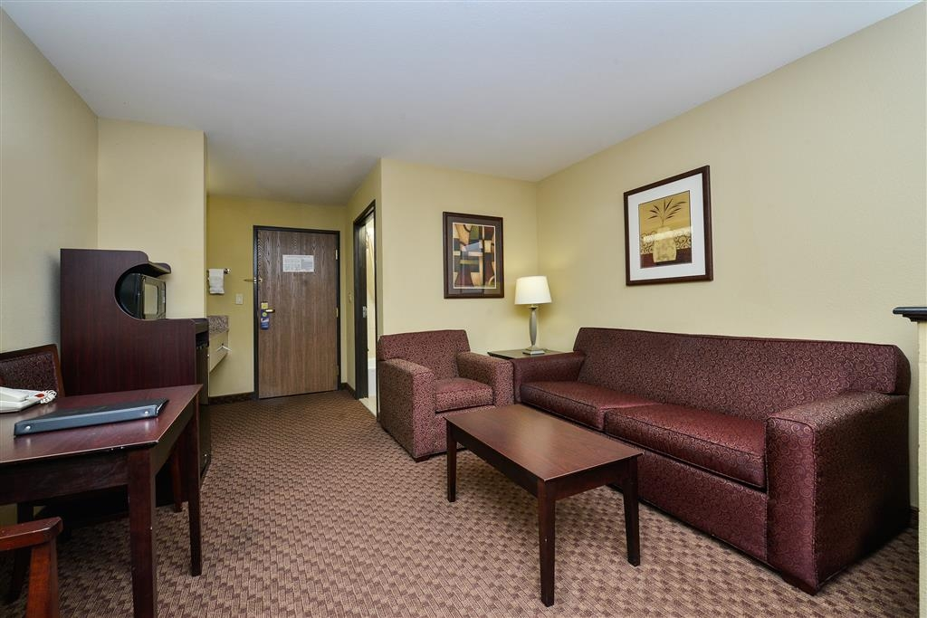 Best Western Plus Mansfield Inn & Suites - This living room available in our 2 queen suite offers plenty of space to eat and work.