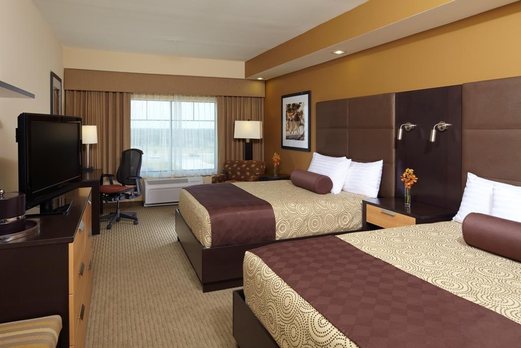 Best Western Premier Bryan College Station - The double queen guest room is perfect for your family and spacious enough to feel like home.
