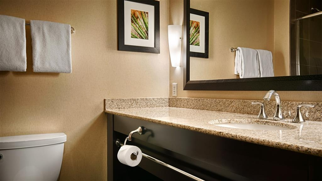 Best Western Premier Bryan College Station - All guest bathrooms have a large vanity with plenty of room to unpack the necessities.