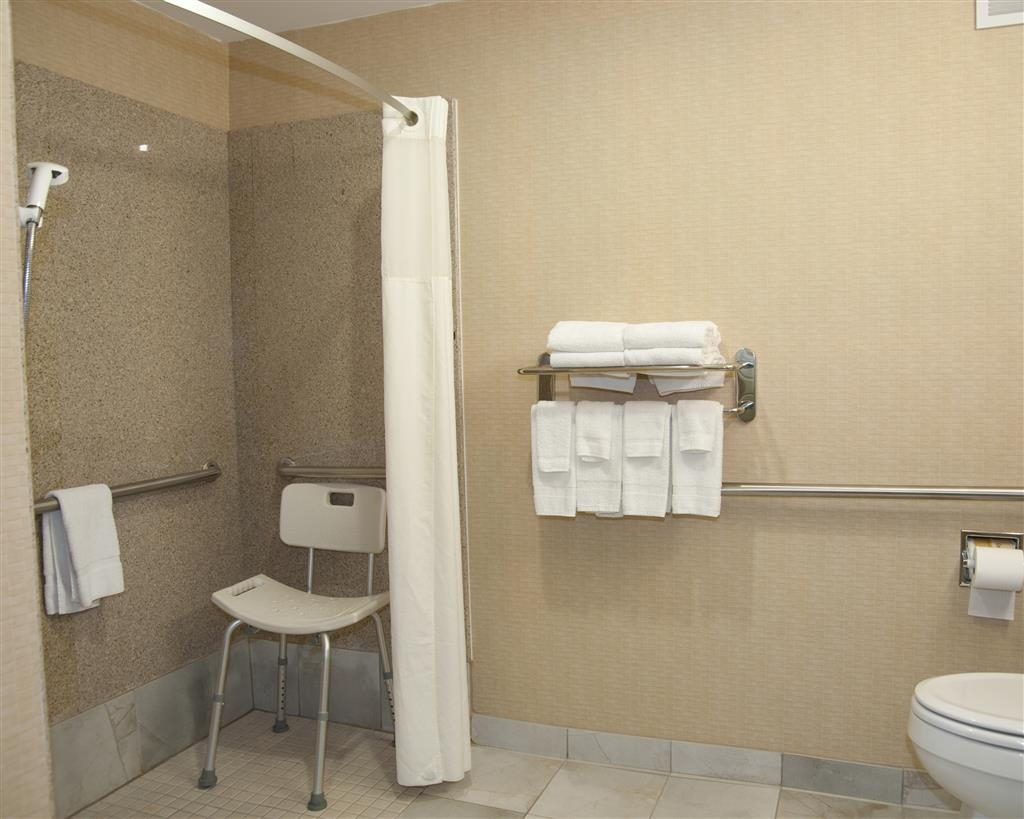 Best Western Comanche Inn - Our mobility accessible bathroom features a roll-in shower.