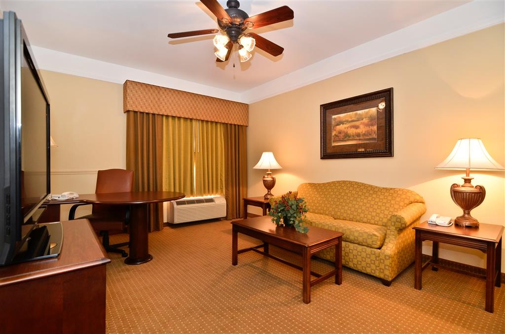 Best Western Plus Monica Royale Inn & Suites - Our gorgeous two room king suite offers a flat screen TV, microwave, mini-refrigerator, ceiling fan, sofa sleeper, and large work desk.