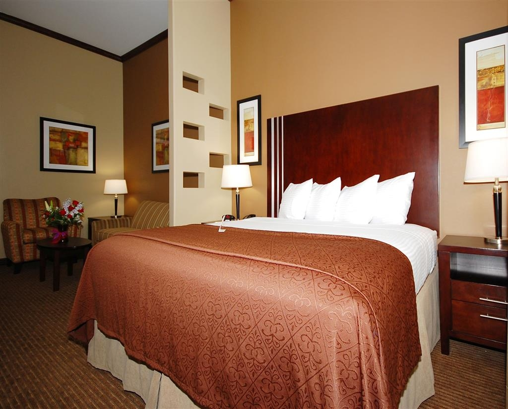 Best Western Plus Texoma Hotel & Suites - This spacious guest suite offers distinct areas for sleeping, eating and working.