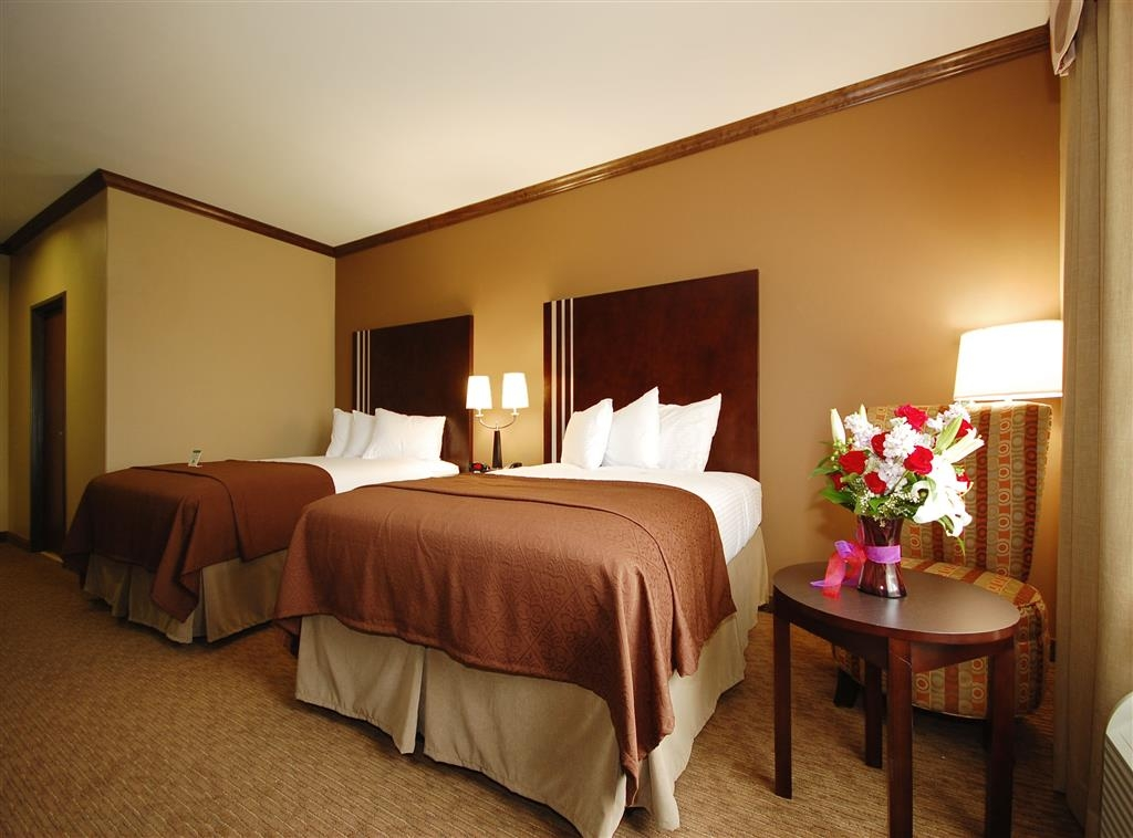 Best Western Plus Texoma Hotel & Suites - Our two queen guest room offers plenty of space for the entire family!
