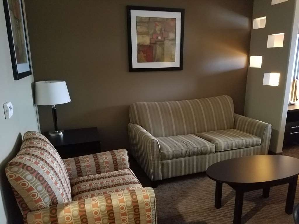 Best Western Plus Texoma Hotel & Suites - Lounge and watch TV in the sitting area of the accessible King Bed Suite.
