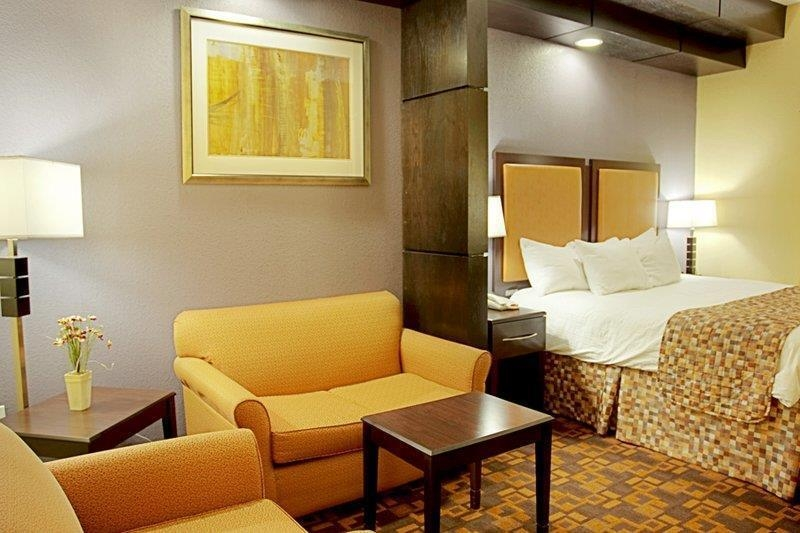Best Western Bowie Inn & Suites - This contemporary king suite offers distinct areas for sleeping eating and working.