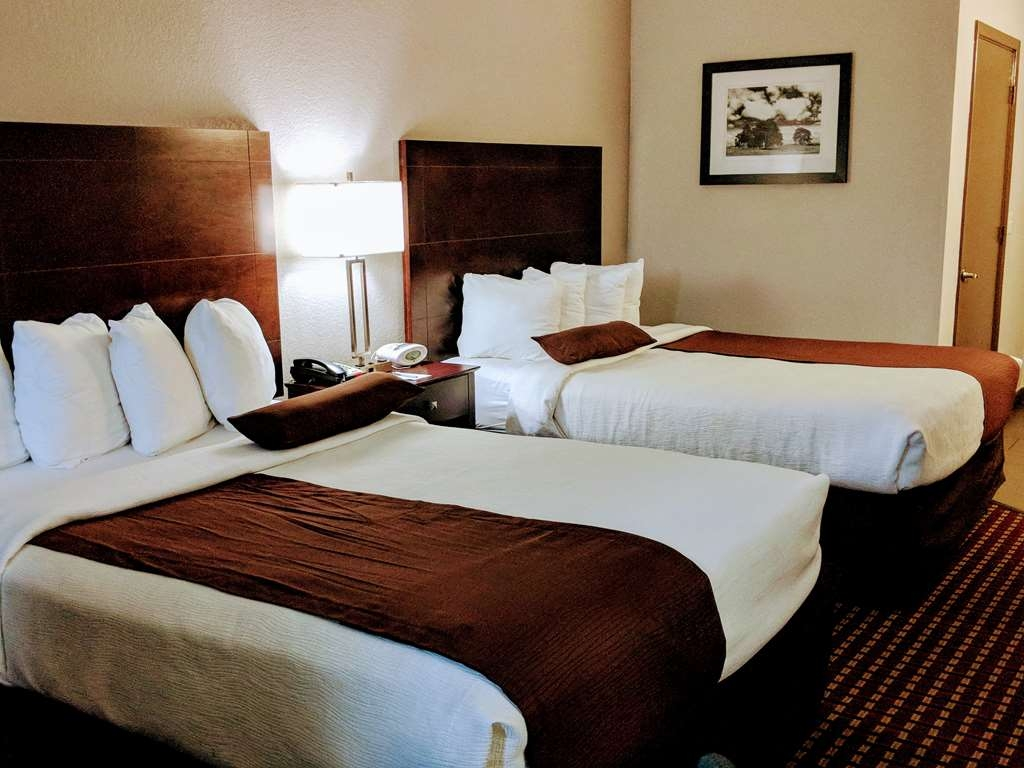Best Western Plus University Inn & Suites - Have the perfect family trip in Wichita Falls, TX and stay in our two queen guest room, each room has a 42-inch flat screen, microwave and mini-fridge.
